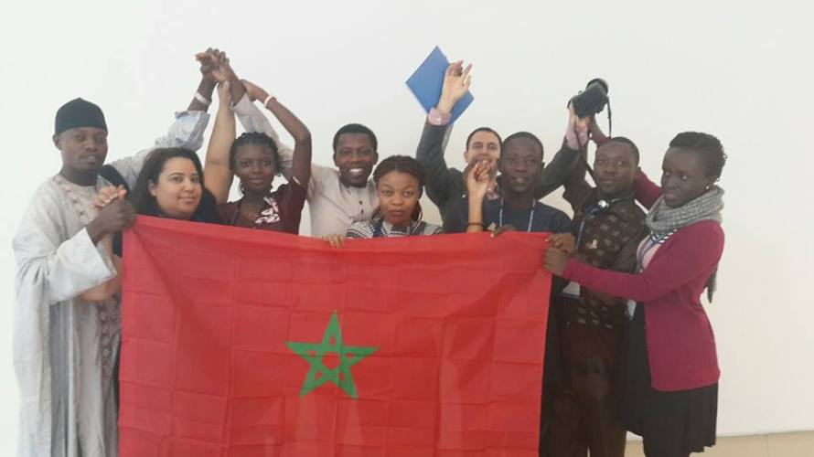 Group photo of African delegates with the Moroccan flag to participate in a campaign launched by Forum Anfa against all type of racism on Subsaharan African. A message of solidarity and encouragement to this initiative launched by Moroccan civil society actors